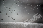Rain-drops-on-glass-and-snow1241